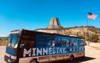 Minnestay RV in front of Devil's Tower.
