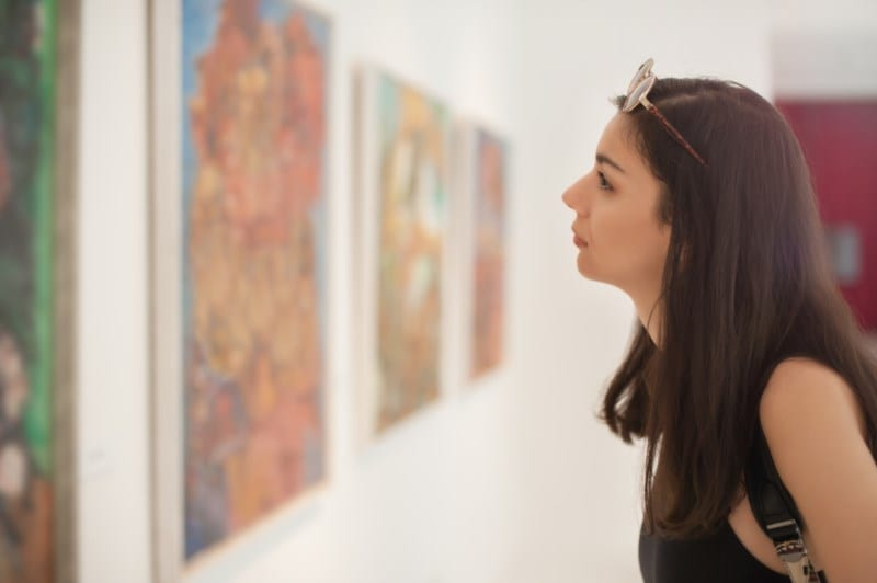 Woman looking at a painting.
