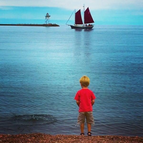 Child watching boats on Grand Marais.
