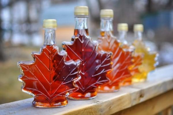 Maple syrup in leaf-shaped bottles.