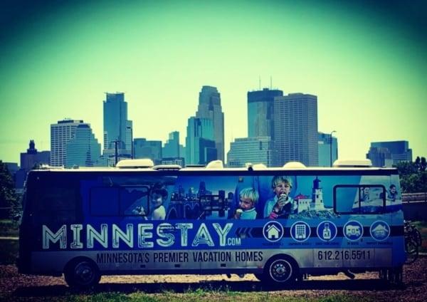 Minnestay RV in front of Minneapolis skyline.