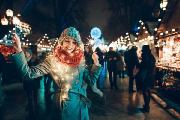 Woman with Christmas lights around her scarf.