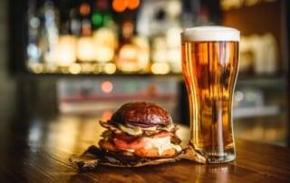 Hamburger and glass of beer.