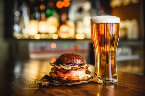 Hamburger and glass of beer.
