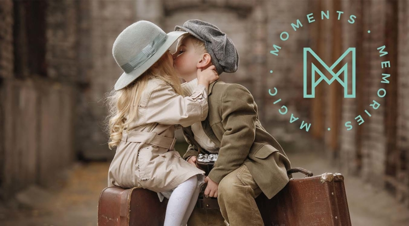Kids sitting on suitcases and kissing. Text: Moments, Memories, Magic, Minnestay Logo.