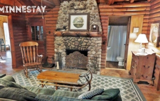 Cabin living room and fireplace.