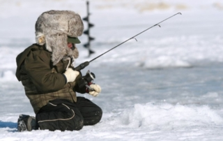 Young person ice fishing.