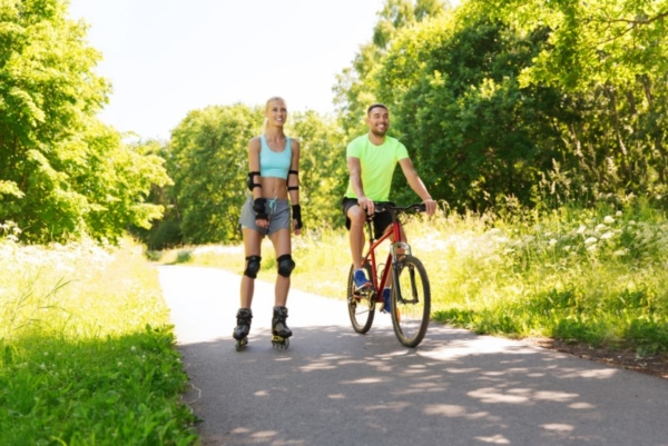 Rollerblader and cyclist on a trail.