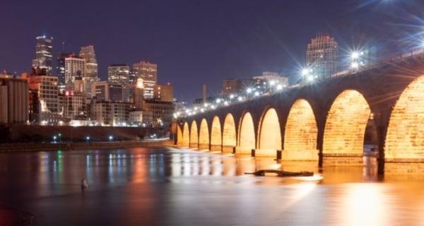 Minneapolis Stone Arch Bridge and Skyline at night.