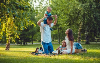Photo of a Family Enjoying a Picnic in the Park.